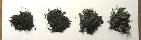 Dry tea leaves: Cui Feng, Xiang Cha, Green Monkey, Snow Buds (left to right)